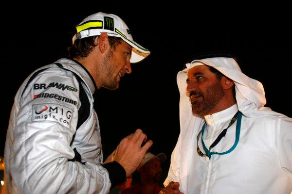 Yas Marina Circuit, Abu Dhabi, United Arab Emirates1st November 2009.Jenson Button, Brawn GP BGP001 Mercedes, 3rd position, with Mohammed Bin Sulayem. Portrait. VIPs.World Copyright: Charles Coates/LAT Photographic ref: Digital Image _26Y3179