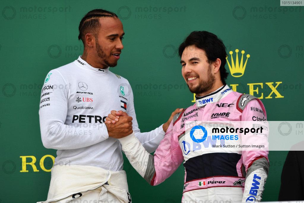 Race winner Lewis Hamilton (GBR) Mercedes-AMG F1 and Sergio Perez (MEX) Force India celebrate on the podium