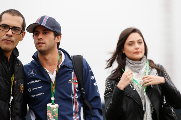 Interlagos, Sao Paulo, Brazil. Friday 7 November 2014. Felipe Nasr, Test and Reserve Driver, Williams F1, poses for a photo with a fan. World Copyright: Charles Coates/LAT Photographic. ref: Digital Image _N7T7386
