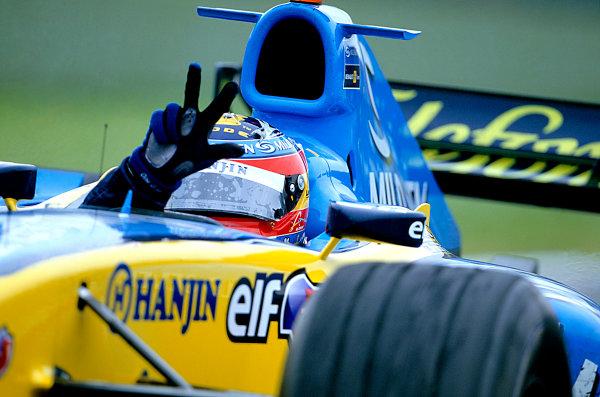 2005 San Marino Grand Prix.Imola, Italy. 24th April 2005.Fernando Alonso, Renault R25 celebrates his third victory of the season. World Copyright: Steven Tee/LAT Photographic Ref: 35mm Image A01
