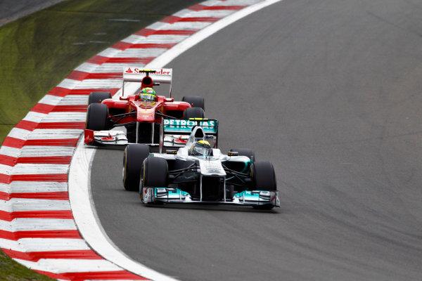 Nurburgring, Germany24th July 2011Nico Rosberg, Mercedes GP W02, 7th position, leads Felipe Massa, Ferrari 150° Italia, 5th position. Action. World Copyright: Charles Coates/LAT Photographicref: Digital Image _D1E3813