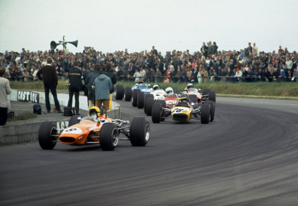 Silverstone, Great Britain. 19 July 1969.Alan Rollinson (Chevron B15 - Ford/Holbay), 1st position, leads Ronnie Peterson (Tecno 69-Novamotor), 3rd position, at the start, action.World Copyright: LAT PhotographicRef: 69BF3 01