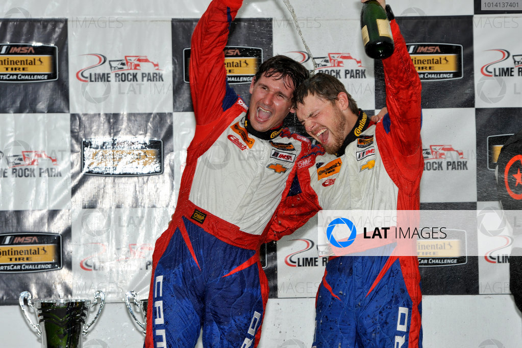 23-24 May, 2014, Lakeville, Connecticut USA 9, Camaro, GS.R, GS, Andy Lally, Matt Bell celebrate their podium finish ©2014 Scott R LePage  LAT Photo USA