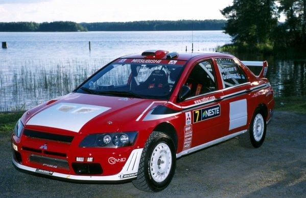 The new Mitsubishi Lancer Evo World Rally Car Step 2.FIA World Rally Championship, Rd9, Neste Rally Finland, Finland. 8-11 August 2002.BEST IMAGE