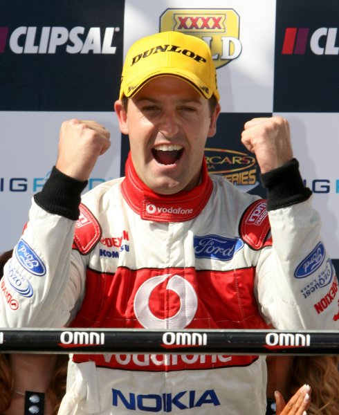The Triple Eight Racing V8 Supercar of Jamie Whincup celebrates on the podium after winning the Clipsal 500, Round 01 of the Australian V8 Supercar Championship Series at the Adelaide Street Circuit, Adelaide, South Australia, February 24, 2008.