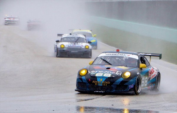 27-29 March, 2012, Homestead, Florida USA The #68 Porsche of Emilio DiGuida and Jergoen Bleekemolen leads a pack of GT cars in the rain. (c)2012, R.D. Ethan LAT Photo USA