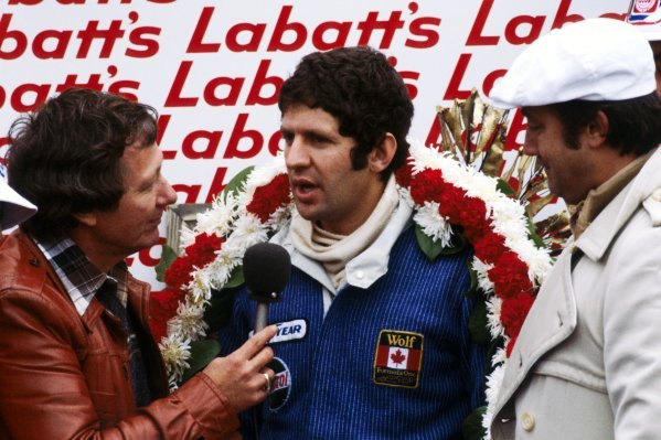 Race winner Jody Scheckter (RSA) (Centre) Wolf is interviewed on the podium with Walter Wolf (CDN) Wolf Team Owner (Right) beside him.Canadian Grand Prix, Rd 16, Mosport Park, Canada, 9 October 1977.BEST IMAGE