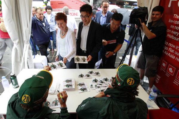 Albert Park, Melbourne, Australia24th March 2011.Jarno Trulli, Team Lotus Renault T128 and Heikki Kovalainen, Team Lotus Renault T128 sign their autogrpahs for fans.World Copyright: Charles Coates/LAT Photographicref: Digital Image _X5J5998