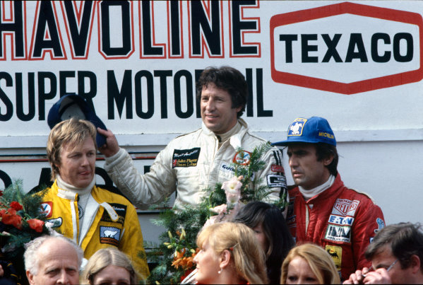 Zolder, Belgium. 19 - 21 May 1978. Mario Andretti (Lotus 79-Ford) 1st position, with Ronnie Peterson (Lotus 79-Ford), 2nd position and Carlos Reutemann (Ferrari 312T3) 3rd position on the podium, portrait.  World Copyright: LAT Photographic. Ref: 78BEL13
