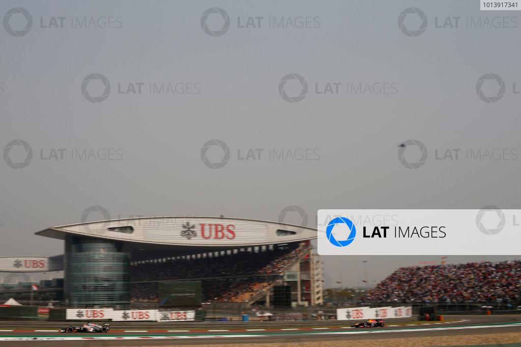 Shanghai International Circuit, Shanghai, China Sunday 14th April 2013 Nico Hulkenberg, Sauber C32 Ferrari, leads Sebastian Vettel, Red Bull RB9 Renault.  World Copyright: Glenn Dunbar/LAT Photographic ref: Digital Image _89P8276