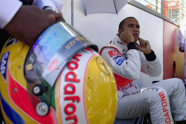 Lewis Hamilton sits on the grid ahead of his first F1 race.