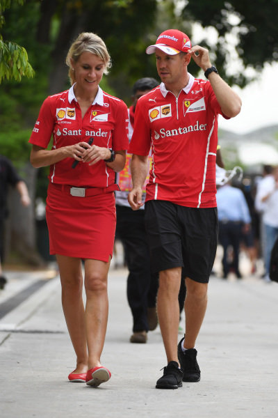 Sebastian Vettel (GER) Ferrari with his PA Britta Roeske (AUT) at Formula One World Championship, Rd15, Malaysian Grand Prix, Practice, Sepang, Malaysia, Friday 29 September 2017.