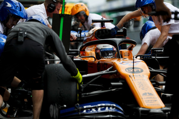 Carlos Sainz Jr., McLaren MCL34, makes a pit stop during practice
