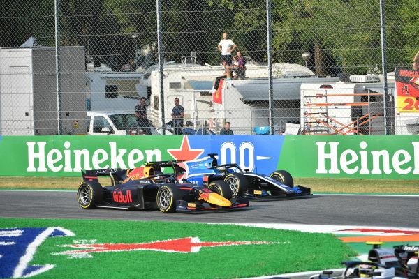 Juri Vips (EST, Hitech Grand Prix), battles with Guanyu Zhou (CHN, Uni-Virtuosi Racing)