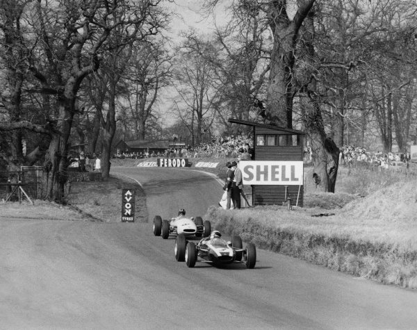 Jackie Stewart, Cooper T75 BRM, leads Graham Hill, Brabham BT16 BRM, out of Deer Leap in the fight for second behind Denny Hulme.