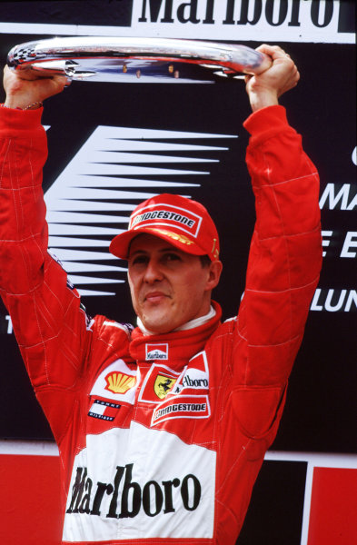 2001 Spanish Grand PrixCatalunya, Barcelona, Spain. 27-29 April 2001.Michael Schumacher (Ferrari) holds his trophy above his head, after his third win this season.World Copyright - LAT Photographicref: 35mm Image