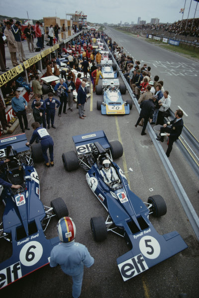 Jackie Stewart, Tyrrell 003 Ford, in the pits as teammate Francois Cevert, Tyrrell 002 Ford, walks to his car, during practice.