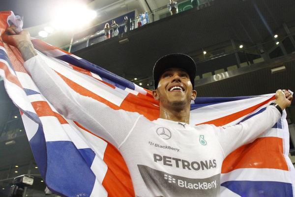 Lewis Hamilton (GBR) Mercedes AMG F1 celebrates. Formula One World Championship, Rd19, Abu Dhabi Grand Prix, Race, Yas Marina Circuit, Abu Dhabi, UAE, Sunday 23 November 2014.  BEST IMAGE