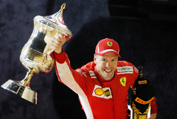 Sebastian Vettel, Ferrari, 1st position, celebrates with his trophy.