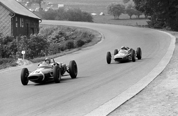 Ninth place finisher Lucien Bianchi (BEL) Lotus 18/21 leads Jo Siffert (SUI) Lotus 21 who finished tenth on his Grand Prix race debut. Belgian Grand Prix, Spa-Francorchamps, 17 June 1962.