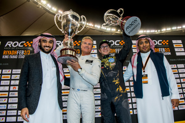 2018 Race Of Champions King Farhad Stadium, Riyadh, Abu Dhabi. Saturday 3 February 2018 Winner David Coulthard (GBR) and runner up Petter Solberg (NOR) celebrate on the podium with Prince Khaled Al Faisal, President of the Motor Federation Of Saudi Arabia. Copyright Free FOR EDITORIAL USE ONLY. Mandatory Credit: 'Race of Champions'