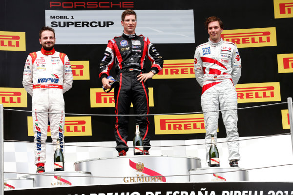 Circuit de Catalunya, Barcelona, Spain. Sunday 10 May 2015. Michael Ammermuller, No.5 Lechner Racing Middle East, 1st position, Kuba Giermaziak, No.1 VERVA Lechner Racing Team, 2nd position, and Christian Engelhart, No.14 MRS GT-Racing, 3rd position, on the podium. World Copyright: Alastair Staley/LAT Photographic. ref: Digital Image _79P8843