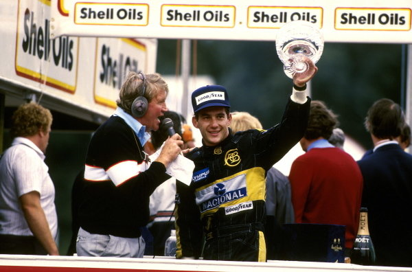 Ayrton Senna (BRA) Lotus 97T, 2nd place is interviewed by commentator Brian Jones (GBR) Formula One World Championship, Rd14, European Grand Prix, Brands Hatch, England, 6 October 1985.