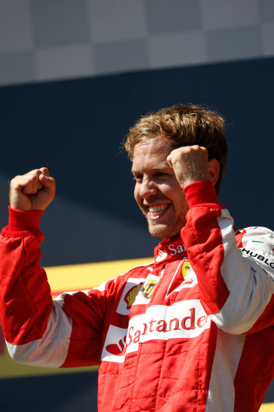 Hungaroring, Budapest, Hungary. Sunday 26 July 2015. Sebastian Vettel, Ferrari, 1st Position, celebrates victory on the podium. World Copyright: Charles Coates/LAT Photographic ref: Digital Image _J5R8424