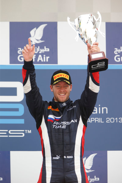 2013 GP2 Series. Round 2.  Bahrain International Circuit, Sakhir, Bahrain. 21st April.  Sunday Race.  Sam Bird (GBR, RUSSIAN TIME) celebrates his victory on the podium.  World Copyright: Glenn Dunbar/GP2 Series Media Service. Ref: _89P4342
