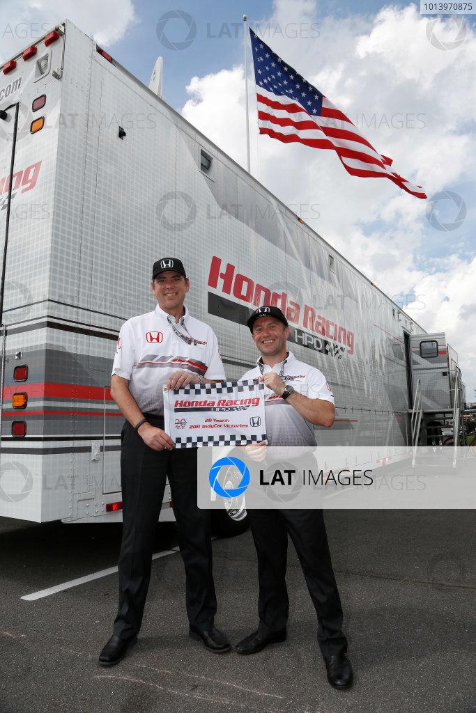 4-7 July, 2013, Long Pond, PA, USA Honda HPD VP Steve Eriksen and technical director Roger Griffiths celebrate 200 Honda IndyCar wins © 2013, Michael L. Levitt LAT Photo USA.