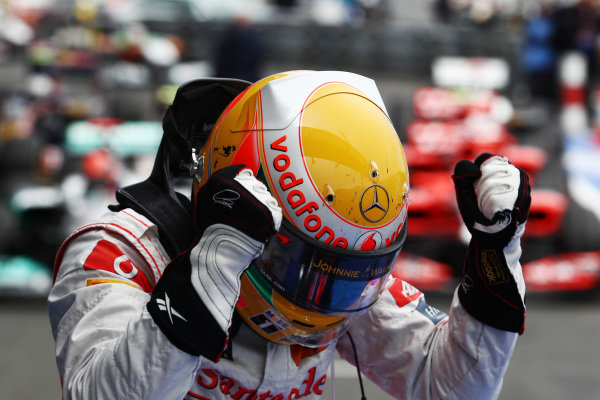 Race winner Lewis Hamilton (GBR) McLaren MP4/26 in parc ferme.  Formula One World Championship, Rd 10, German Grand Prix, Race, Nurburgring, Germany, Sunday 24 July 2011.  BEST IMAGE