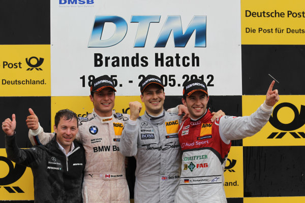 Brands Hatch, Kent, UK18th - 20th May 20122nd place Bruno Spengler (CAN) BMW Team Schnitzer BMW M3 DTM with 1st place Gary Paffett (GBR), Team HWA AMG Mercedes, AMG Mercedes C-Coupe and 3rd place Mike Rockenfeller (GER) Audi Sport Team Phoenix Racing Audi A5 DTM World Copyright: XPB Images/LAT Photographicref: Digital Image 2185569_HiRes