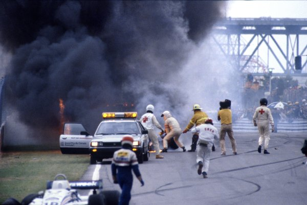 1982 Canadian Grand Prix.Montreal, Canada. 13 June 1982.Marshals try in vain to put out the fire that engulfed Riccardo Paletti, Osella FA1C-Ford, with fatal consequences.World Copyright: LAT PhotographicRef: 35mm transparency 82CAN39