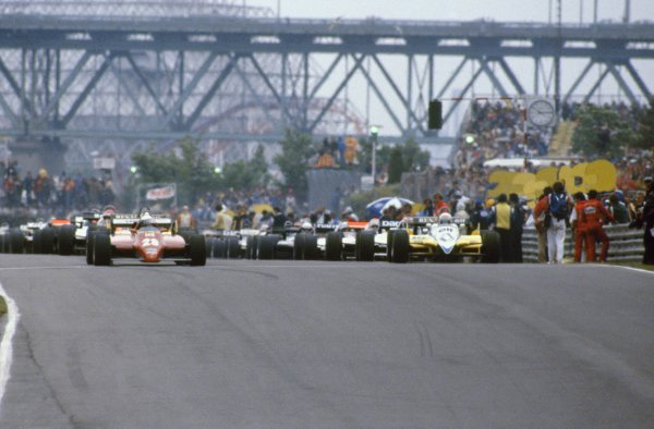 1982 Canadian Grand Prix.Montreal, Canada. 13 June 1982.Didier Pironi, Ferrari 126C2, 9th position, and Rene Arnoux, Renault RE30B, retired, leave on the parade lap, action.World Copyright: LAT PhotographicRef: 35mm transparency 82CAN34