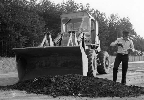 Race winner Jackie Stewart (GBR) oversees resurfacing work carried out to the circuit which threatened the running of the GP. Belgian Grand Prix, Rd 5, Zolder, Belgium, 20 May 1973.