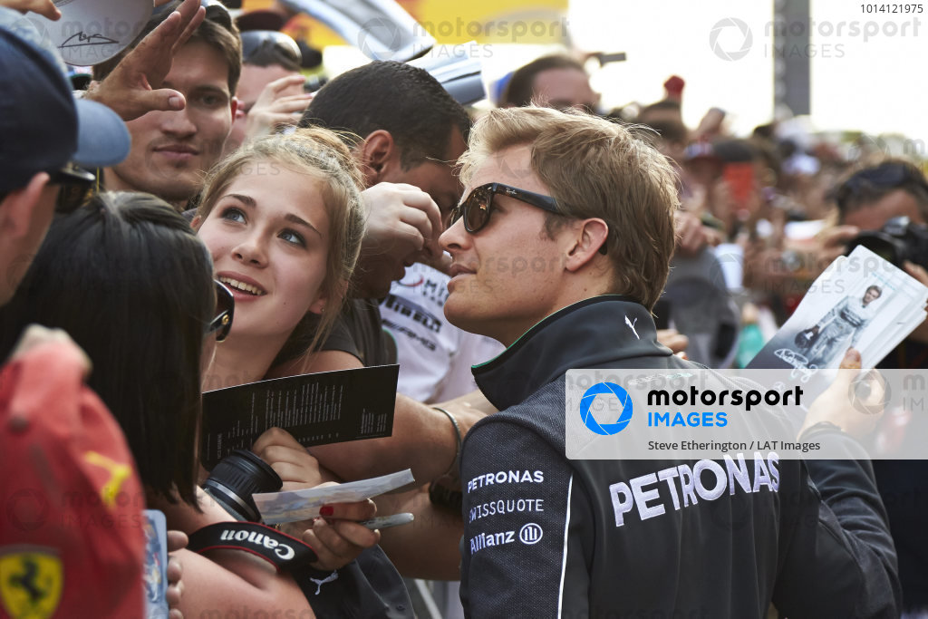 Circuit de Catalunya, Barcelona, Spain. Thursday 8 May 2014. Nico Rosberg, Mercedes AMG, signs autographs for fans. World Copyright: Steve EtheringtonLAT Photographic. ref: Digital Image SNE22279 copy