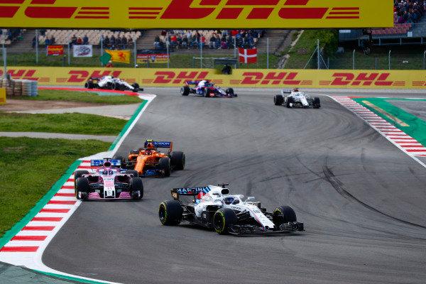 Lance Stroll, Williams FW41 Mercedes, leads Sergio Perez, Force India VJM11 Mercedes, Stoffel Vandoorne, McLaren MCL33 Renault, and Marcus Ericsson, Sauber C37 Ferrari.