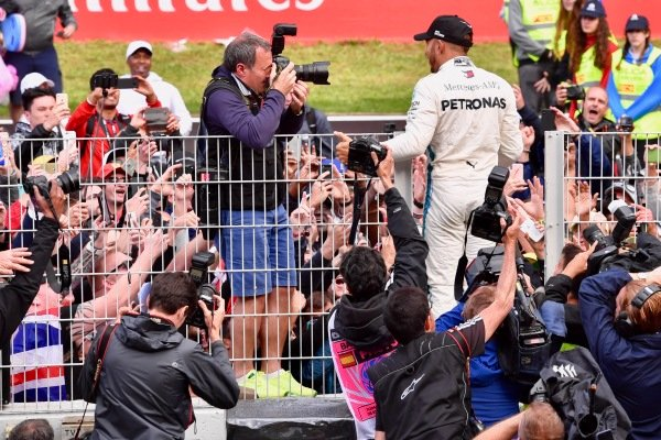Race winner Lewis Hamilton (GBR) Mercedes-AMG F1 celebrates with the fans