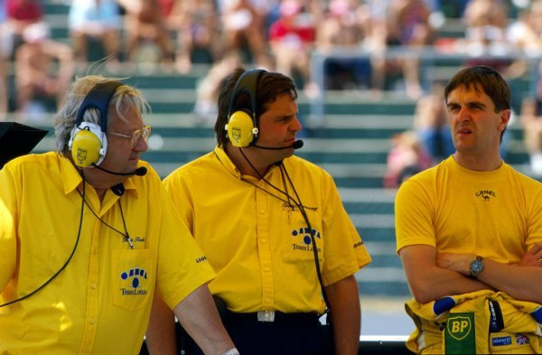 The pitwall (L to R): Tony Rudd (GBR) Lotus Team Chairman; Rupert Mainwaring (GBR) Lotus Team Manager; Martin Donnelly (GBR) Lotus, who retired on the second lap of the race with a broken clutch. German Grand Prix, Rd 9, Hockenheim, 29 July 1990.