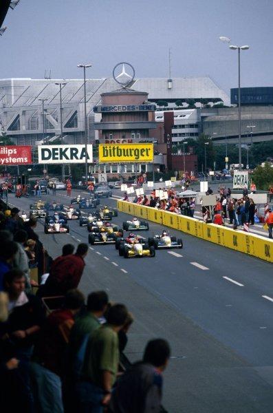 Race winner Jos Verstappen (NED) Opel Team WTS Dallara 393-Opel leads the field at the start of the race. German Formula Three Championship, Avus, Germany, 11 September 1993.