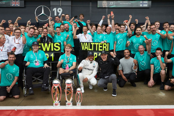 Silverstone, Northamptonshire, UK.  Sunday 16 July 2017. Lewis Hamilton, Mercedes AMG, and Valtteri Bottas, Mercedes AMG, celebrate with Billy Monger and the team. World Copyright: Steve Etherington/LAT Images  ref: Digital Image SNE10385