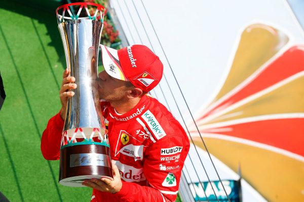 Hungaroring, Budapest, Hungary.  Sunday 30 July 2017. Sebastian Vettel, Ferrari, 1st Position, celebrates on the podium with his trophy. World Copyright: Andrew Hone/LAT Images  ref: Digital Image _ONZ1179