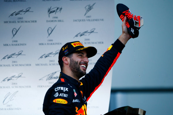 Baku City Circuit, Baku, Azerbaijan. Sunday 25 June 2017. Daniel Ricciardo, Red Bull Racing, celebrates his victory on the podium with champagne in his shoe. World Copyright: Andy Hone/LAT Images ref: Digital Image _ONY9240