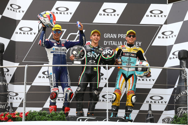 2017 Moto3 Championship - Round 6 Mugello, Italy Sunday 4 June 2017 Podium: second place Fabio Di Giannantonio, Del Conca Gresini Racing Moto3, Race winner Andrea Migno, Sky Racing Team VR46, third place Juan Francisco Guevara, RBA Racing Team World Copyright: Gold & Goose Photography/LAT Images ref: Digital Image 674651