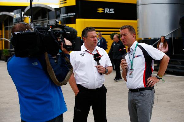 Silverstone, Northamptonshire, UK.  Sunday 16 July 2017. Zak Brown, Executive Director, McLaren Technology Group, talks to Craig Slater of Sky. World Copyright: Andy Hone/LAT Images  ref: Digital Image _ONY7466