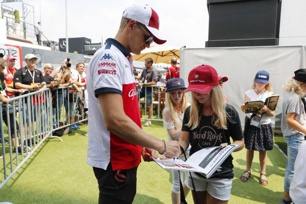 Marcus Ericsson, Saube, signs autographs for young fans.