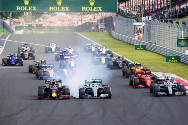 Max Verstappen, Red Bull Racing RB15, leads Lewis Hamilton, Mercedes AMG F1 W10, Valtteri Bottas, Mercedes AMG W10, Charles Leclerc, Ferrari SF90, Carlos Sainz Jr., McLaren MCL34, and the rest of the field at the start
