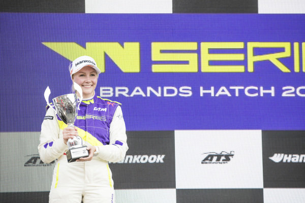 Emma Kimilainen (FIN) celebrates on the podium with the trophy