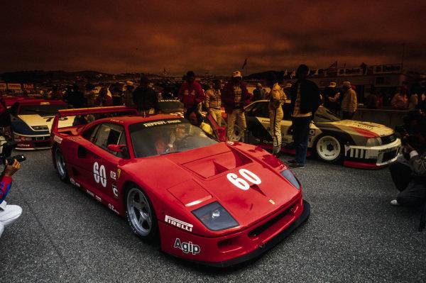 Jean Alesi, Ferrari France, Ferrari F40, alongside Hans-Joachim Stuck, Audi 90 quattro, on the grid.