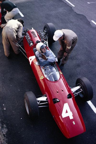 Lorenzo Bandini, Ferrari 158, in the pits.